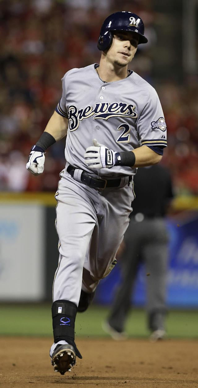 Milwaukee Brewers' Scooter Gennett rounds the bases after hitting a solo home run off Cincinnati Reds relief pitcher Alfredo Simon in the eighth inning of a baseball game, Friday, Aug. 23, 2013, in Cincinnati. Milwaukee won 6-4. (AP Photo/Al Behrman)
