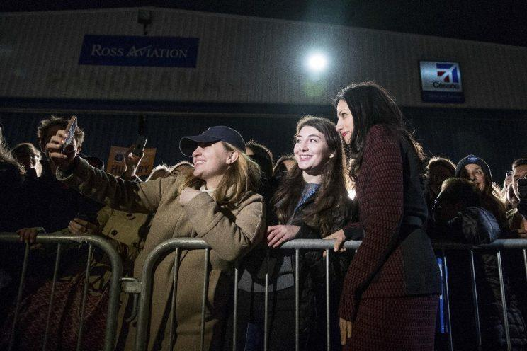 Huma Abedin greets supporters on the tarmac as she arrives on Hillary Clinton's campaign plane in White Plains, N.Y. (Photo: Andrew Harnik/AP)