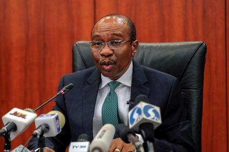 Central Bank Governor Godwin Emefiele speaks during the monthly Monetary Policy Committee meeting in Abuja