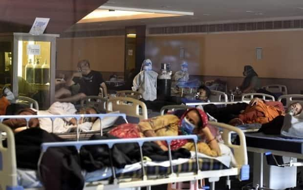 A view inside the temporary Covid Care Centre set up at Shehnai Banquet Hall attached to LNJP Hospital in New Delhi.  (Sonu Mehta/Hindustan Times via Getty Images - image credit)