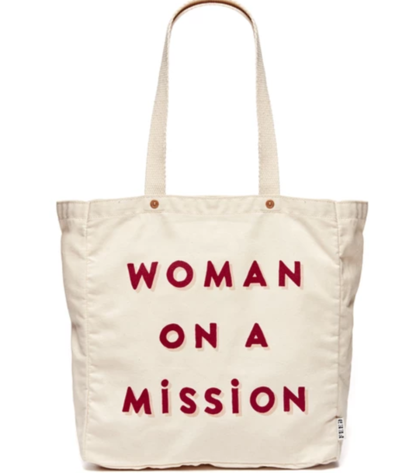 Woman On A Mission Tote - Provides 10 meals. Image via FEED.