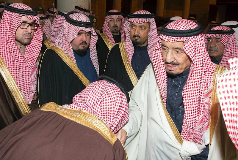 A handout picture released by the Saudi Press Agency shows Saudi well-wishers kissing the hands of their new leader King Salman bin Abdul Aziz in a symbolic pledge of allegiance in January 2015 (AFP Photo/-)