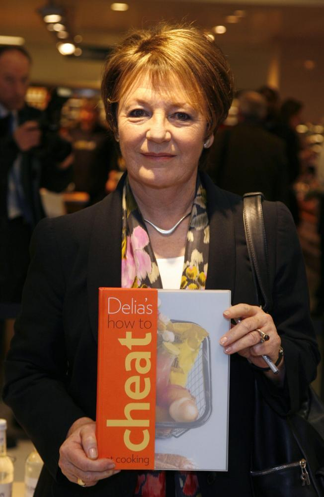 Delia Smith signs copies of her book How to Cheat at Cooking