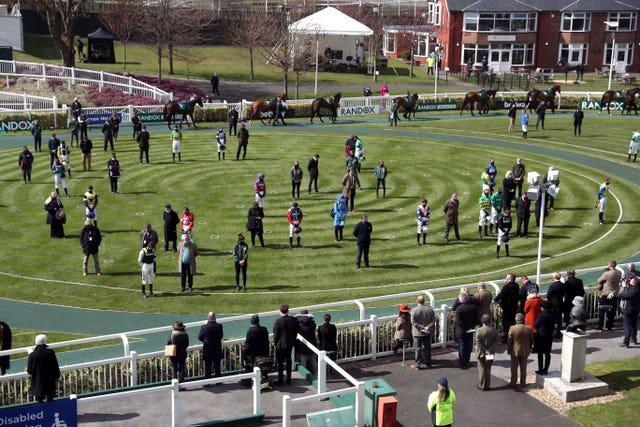 Jockeys, owners and trainers also stood for a two-minute silence at Aintree in Liverpool