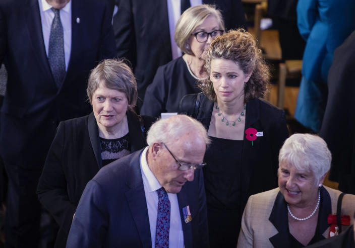 Former Prime Minister Helen Clark, left, with British High Commissioner to New Zealand Laura Clarke, center right, attend a national memorial service for Prince Philip at the Cathedral of St. Paul in Wellington, New Zealand. Prince Philip was remembered as frank, engaging and willing to meet people from all walks of life during his 14 visits to the country. (Robert Kitchin/Pool via AP)