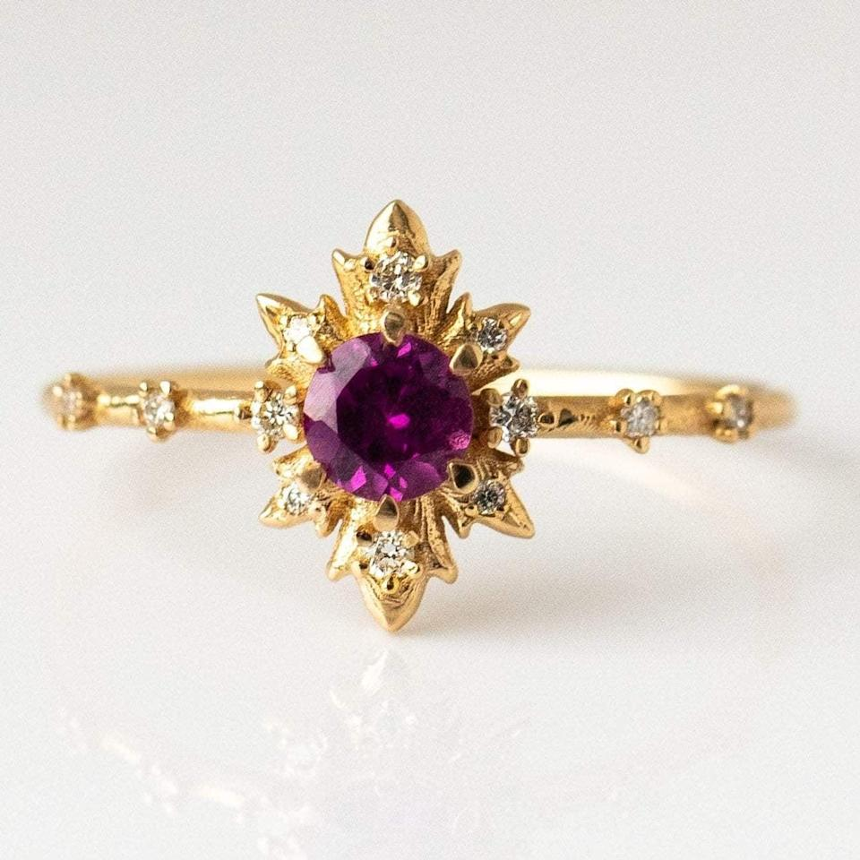 """<p>Once you feast your eyes on the rhodolite stone on the <a href=""""https://www.popsugar.com/buy/Rhodolite-Termina-Ring-Diamonds-532220?p_name=Rhodolite%20Termina%20Ring%20With%20Diamonds&retailer=localeclectic.com&pid=532220&price=850&evar1=fab%3Aus&evar9=7954958&evar98=https%3A%2F%2Fwww.popsugar.com%2Fphoto-gallery%2F7954958%2Fimage%2F47021268%2FRhodolite-Termina-Ring-With-Diamonds&list1=shopping%2Cwedding%2Cjewelry%2Crings%2Cbride%2Cengagement%20rings%2Cfashion%20shopping&prop13=api&pdata=1"""" rel=""""nofollow noopener"""" class=""""link rapid-noclick-resp"""" target=""""_blank"""" data-ylk=""""slk:Rhodolite Termina Ring With Diamonds"""">Rhodolite Termina Ring With Diamonds</a> ($850) you can't look away.</p>"""