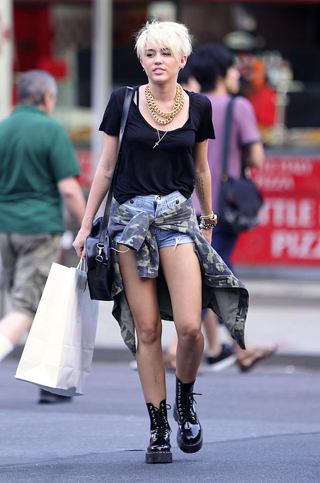 """Just when we were finally getting used to Miley's jagged platinum 'do, she goes and puts a grunge rock twist on her entire wardrobe. What do you make of the ex """"Hannah Montana"""" star's new style? More importantly, what do you think her hubby-to-be, Liam Hemsworth, has to say about this drastic change? (8/23/2012)<br><br><a target=""""_blank"""" href=""""http://omg.yahoo.com/blogs/crush/miley-cyrus-debuts-edgy-never-felt-more-whole-173157366.html"""">Miley debuts an edgy new 'do</a>"""