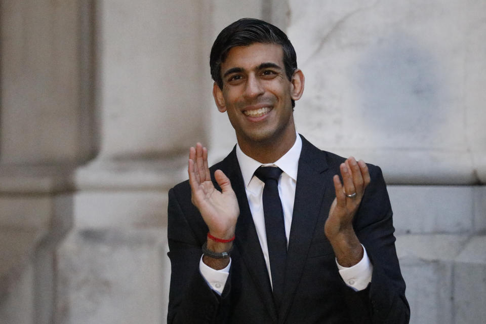 Chancellor of the Exchequer Rishi Sunak clapping outside the Foreign and Commonwealth Office in London to salute local heroes during Thursday's nationwide Clap for Carers initiative to recognise and support NHS workers and carers fighting the coronavirus pandemic.