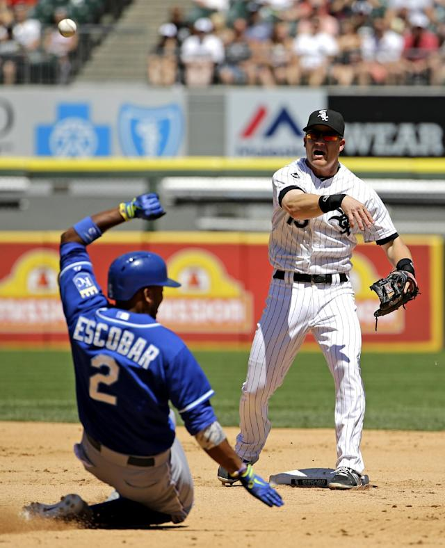 Chicago White Sox second baseman Gordon Beckham, right, throws out Kansas City Royals' Nori Aoki, of Japan, at first base after forcing out Alcides Escobar (2) at second base during the fourth inning of a baseball game in Chicago on Saturday, June 14, 2014. (AP Photo/Nam Y. Huh)