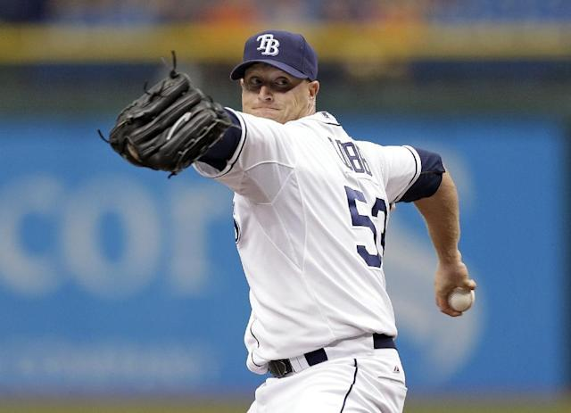 Tampa Bay Rays starting pitcher Alex Cobb delivers to Baltimore Orioles' Nate McLouth during the first inning of a baseball game Saturday, Sept. 21, 2013, in St. Petersburg, Fla. (AP Photo/Chris O'Meara)
