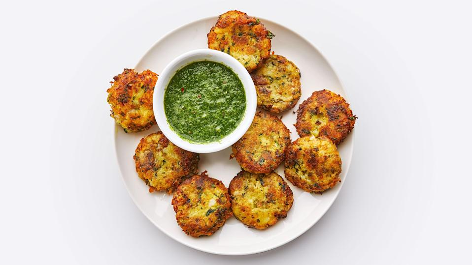 """Crispy, bronzed potato patties and a fiery green sauce to dip them in. <a href=""""https://www.bonappetit.com/recipe/aloo-tikki-with-hari-chutney?mbid=synd_yahoo_rss"""" rel=""""nofollow noopener"""" target=""""_blank"""" data-ylk=""""slk:See recipe."""" class=""""link rapid-noclick-resp"""">See recipe.</a>"""