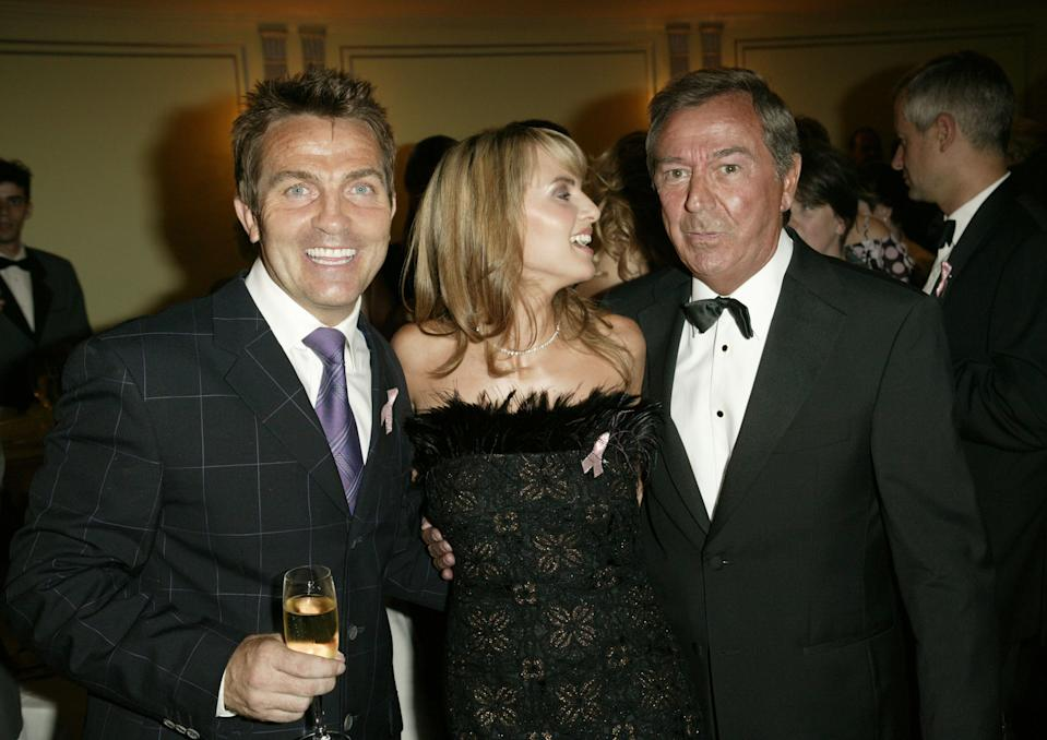 "LONDON - SEPTEMBER 6: Actors Bradley Walsh and Debra Stephenson and presenter Des O'Connor arrive at the ""TV Quick Awards 2004 "" at The Dorchester on September 6, 2004 in London. The annual awards acknowledge the most popular TV programmes and stars in 15 separate categories. (Photo by Dave Hogan/Getty Images)"
