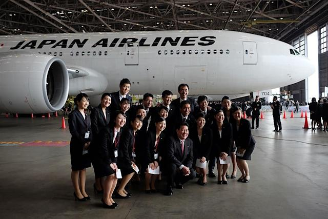 Japan Airlines cabin crew: AFP via Getty Images