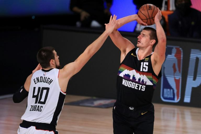 Denver's Nikola Jokic, at right shooting over Ivica Zubac, scored 34 points to spark the Nuggets over the Los Angeles Clippers in an NBA playoff game Sunday