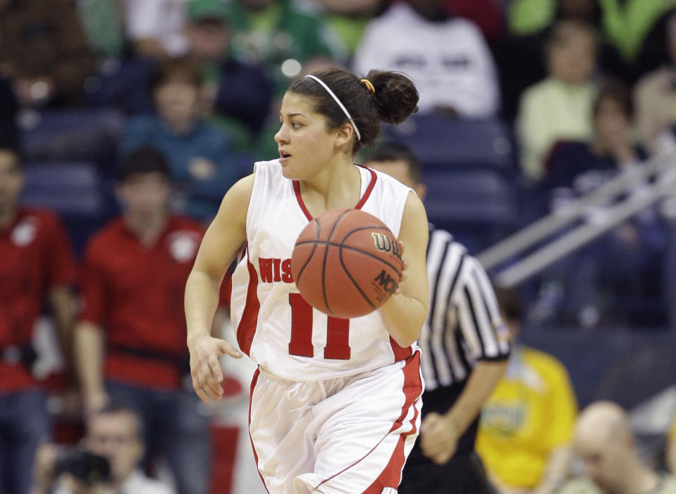 """FILE - In this Sunday, March 21, 2010 file photo, Wisconsin's Rae Lin D'Alie in the second half of an NCAA first-round college basketball game in South Bend, Ind. Rae Lin D'Alie was born and raised in Wisconsin but is the star of Italy's 3-on-3 basketball team at the Tokyo Olympics. """"Rae Rae"""" as she is known usually is the shortest player on the court at 5-foot-3 but is Italy's spark plug and court general. (AP Photo/Michael Conroy, File)"""