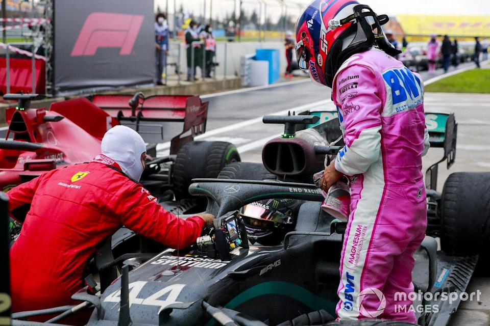 "Race Winner Lewis Hamilton, Mercedes-AMG F1 celebrates his 7th World Championship title in Parc Ferme with Sebastian Vettel, Ferrari and Sergio Perez, Racing Point <span class=""copyright"">Steven Tee / Motorsport Images</span>"