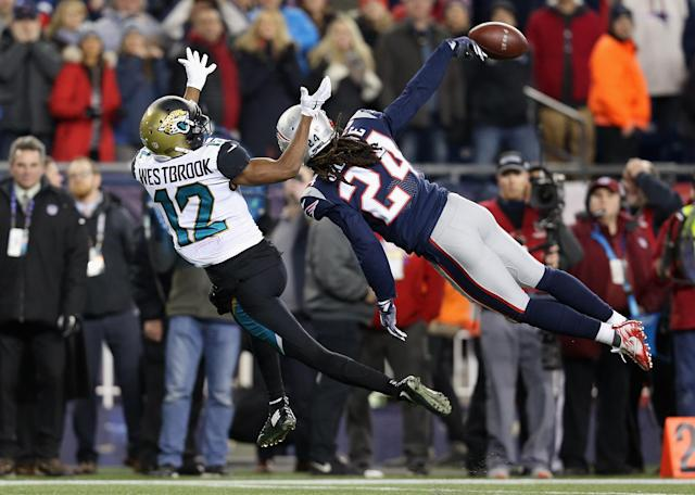 <p>Stephon Gilmore #24 of the New England Patriots deflects a pass intended for Dede Westbrook #12 of the Jacksonville Jaguars in the fouorth quarter during the AFC Championship Game at Gillette Stadium on January 21, 2018 in Foxborough, Massachusetts. (Photo by Kevin C. Cox/Getty Images) </p>