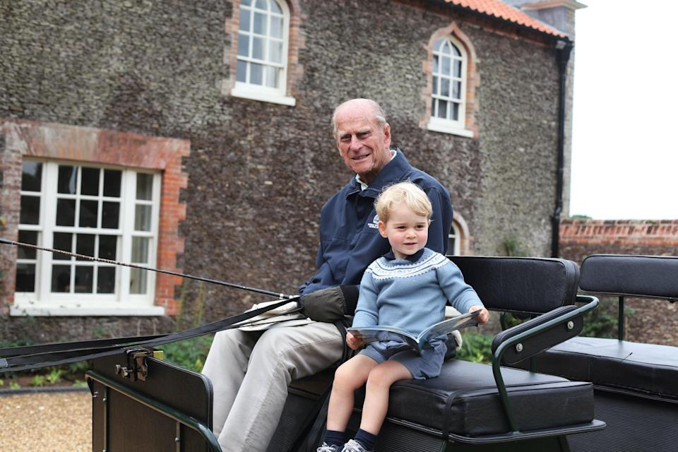 Philp with his great grandson George, taken by Kate in Norfolk in 2015 (Duchess of Cambridge) (PA Media)