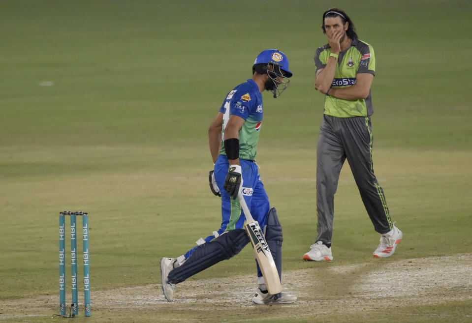 Lahore Qalandars pacer David Wiese, right, reacts while looking towards Multan Sultans batsman Shan Masood during the second eliminator cricket match of Pakistan Super League T20 cup at National Stadium in Karachi, Pakistan, Sunday, Nov. 15, 2020. (AP Photo/Fareed Khan)