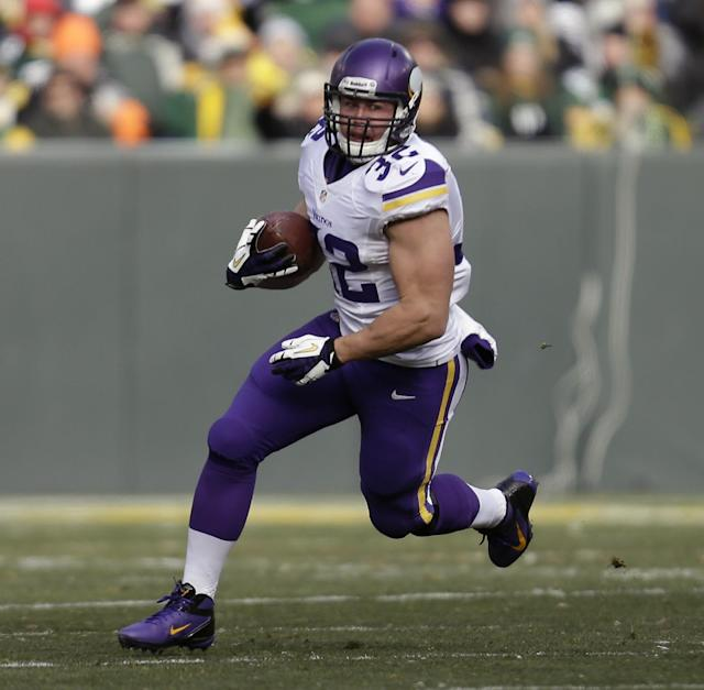 FILE - In this Nov. 24, 2013 file photo, Minnesota Vikings Toby Gerhart runs with the football during an NFL game against the Green Bay Packers at Lambeau Field in Green Bay Wis. The Jaguars contined its offensive makeover Tuesday night, March 11, 2014, by agreeing to terms with Gerhart, a possible indication Jacksonville doesn't expect free agent Maurice Jones-Drew to return. (AP Photo/Mike McGinnis, File)