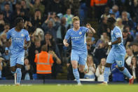 Manchester City's Kevin De Bruyne, centre, celebrates with teammate's Romeo Lavia, right, and Joshua Wilson-Esbrand after scoring his team's first goal during the English League Cup third round soccer match between Manchester City and Wycombe Wanderers at Etihad Stadium, in Manchester England, Tuesday, Sept. 21, 2021. (AP Photo/Dave Thompson)