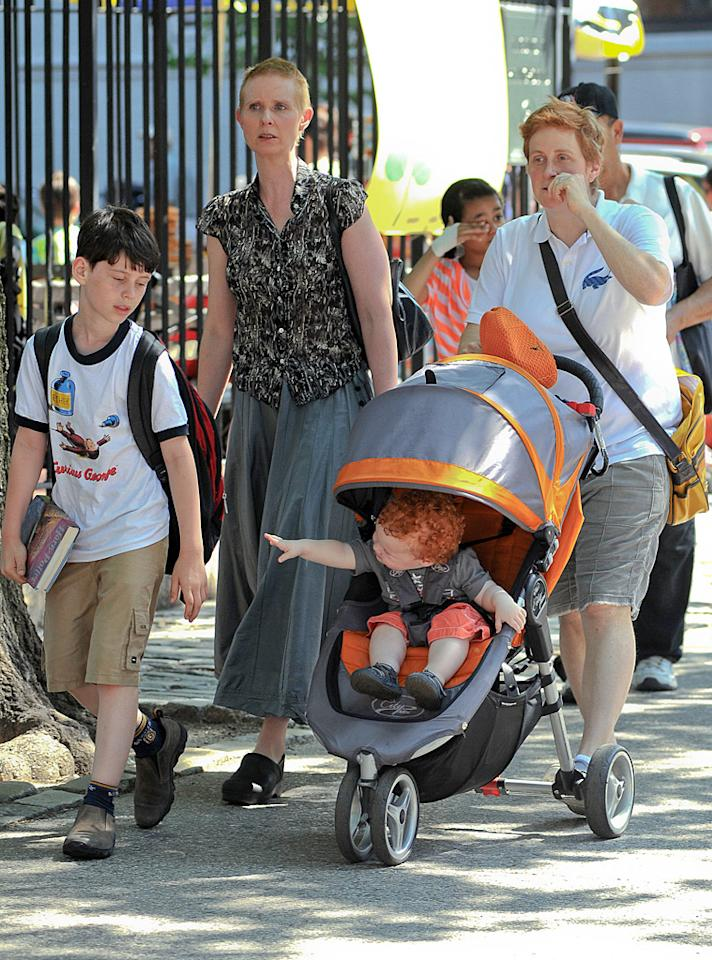 "Just two days after getting hitched,""Sex and the City"" star Cynthia Nixon and her new wife Christine Marinoni went for a stroll around Manhattan on Tuesday with their 16-month-old son Max Ellington and his big brother, 9-year-old Charles. Charles is Cynthia's son from her long-term relationship with her high school sweetheart Danny Mozes, which ended in 2003. They also have a 15-year-old daughter named Samantha. (5/29/2012)"