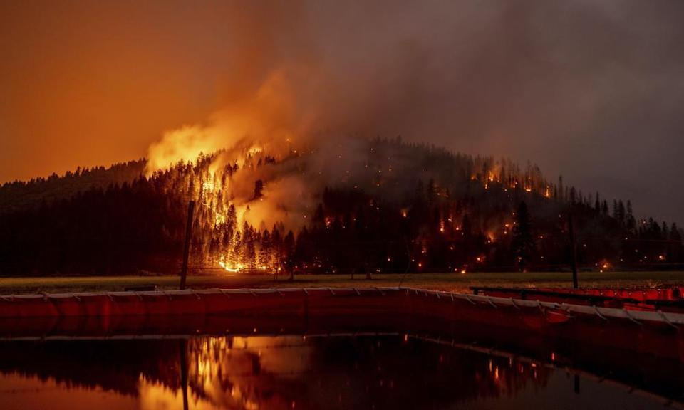 A long exposure photo showing flames from the Dixie Fire in Genesee, California, US.