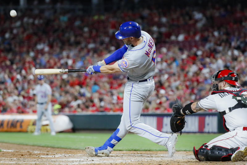 New York Mets' Jeff McNeil hits a solo home run off Cincinnati Reds starting pitcher Luis Castillo in the sixth inning of a baseball game Friday, Sept. 20, 2019, in Cincinnati. (AP Photo/John Minchillo)