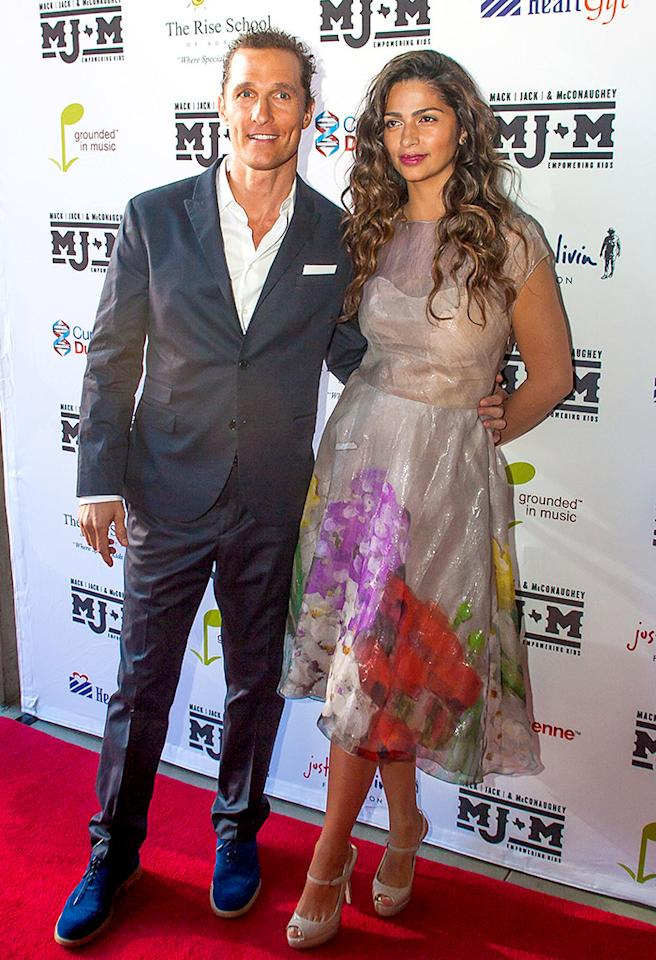 Matthew McConaughey's better half, Camila Alves, looked cute as can be on her man's arm in this floral Lela Rose frock at a recent charity event in Austin, Texas. The length, the silhouette, the everything ... amazing, as were her freshly highlighted locks and nude peep-toes. (4/11/2013)
