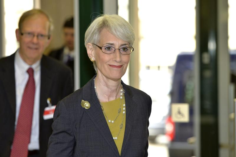 U.S. Under Secretary of State for Political Affairs Wendy Sherman arrives prior to the start of two days of closed-door nuclear talks at the United Nations offices in Geneva Switzerland, Thursday, Nov. 7, 2013. Six world powers are dangling the prospect of easing some sanctions against Iran if Tehran agrees to curb work that could be used to make nuclear weapons. Talks resume Thursday between Iran and the six _ The United States, Russia, China, Britain, France and Germany. (AP Photo/Keystone, Martial Trezzini)