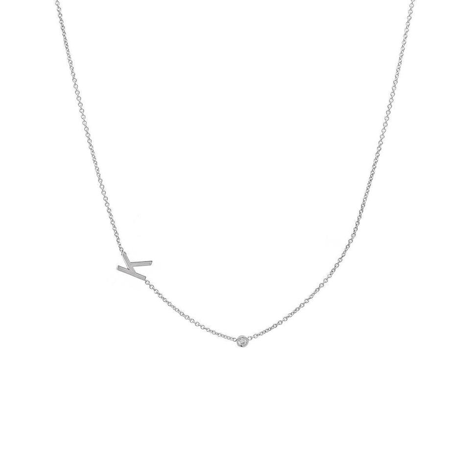 "<br><br><strong>Bychari</strong> Asymmetrical Initial & Diamond Necklace, $, available at <a href=""https://go.skimresources.com/?id=30283X879131&url=https%3A%2F%2Fbychari.com%2Fcollections%2Fcustom-pieces%2Fproducts%2Fasymmetrical-initial-diamond-necklace"" rel=""nofollow noopener"" target=""_blank"" data-ylk=""slk:Bychari"" class=""link rapid-noclick-resp"">Bychari</a>"