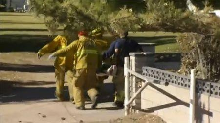 A still image from a video footage courtesy of Nbcla.com shows first responders transporting an injured person at a shooting at the California Department of Developmental Services Inland Regional Center, one of 21 facilities serving people with developmental disabilities, in San Bernardino, California December 2, 2015. REUTERS/NBCLA.COM/Handout