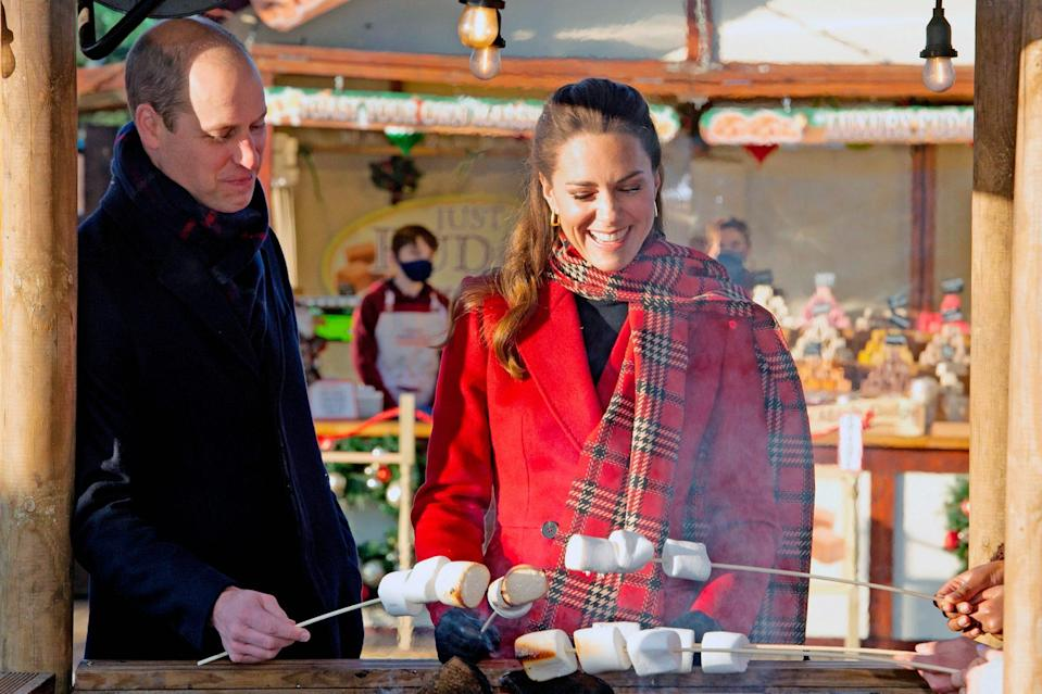 <p>Prince William and Kate Middleton toast some marshmallows together while visiting Cardiff, Wales on Tuesday. </p>
