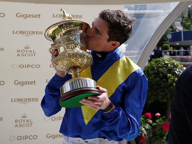 Horse Racing - Royal Ascot - Ascot Racecourse, Ascot, Britain - June 20, 2018 James Doyle on Poet's Word celebrates winning the 4.20 Prince of Wales's Stakes with the trophy Action Images via Reuters/Paul Childs