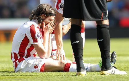 Britain Football Soccer - Stoke City v Liverpool - Premier League - bet365 Stadium - 8/4/17 Stoke City's Joe Allen looks dejected after sustaining an injury Action Images via Reuters / Carl Recine Livepic