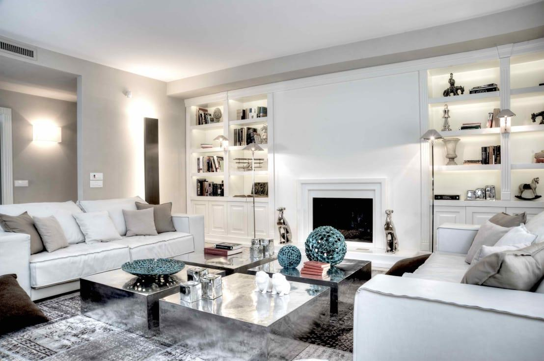<p>For a subtle take on this trend, you can create your boiserie and then paint it white, to match your plain walls. This way, you'll get textural diversity, but an understated finish still. Such a classy way to tap into the look! We love the way the fireplace here has been created to match!</p>  Credits: homify / Ernesto Fusco