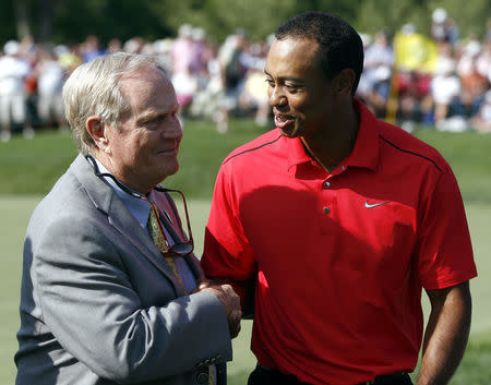 FILE PHOTO: Tiger Woods of the U.S. is congratulated by Jack Nicklaus (L) after his final round of the Memorial Tournament at Muirfield Village Golf Club in Dublin, Ohio, June 3, 2012.  REUTERS/Matt Sullivan