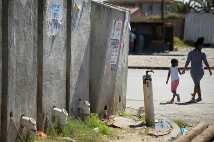 Communal toilets in the informal settlement often overflow, spilling human waste onto the street (AFP Photo/RODGER BOSCH)