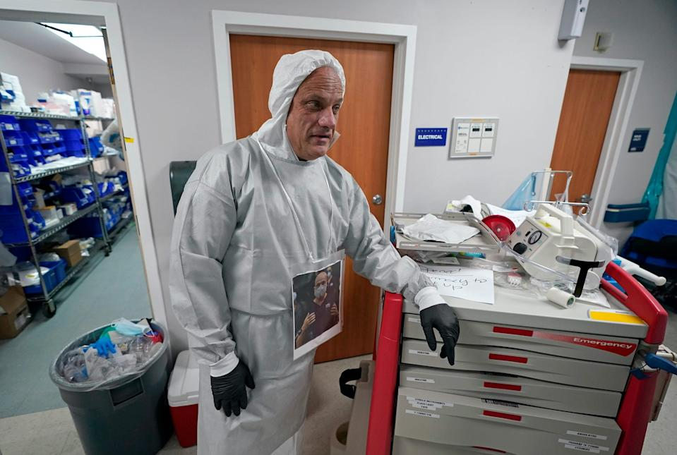 Dr. Joseph Varon leans on a medical cart inside the Coronavirus Unit at United Memorial Medical Center, Monday, July 6, 2020, in Houston.