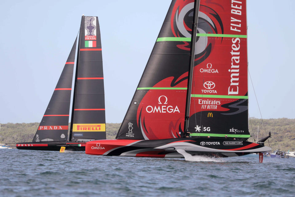 Team New Zealand yacht, right, and Italy's Luna Rossa compete in the America's Cup World Series on the Hauraki Gulf off Auckland, New Zealand, Saturday, Dec. 19, 2020. (Michael Craig/New Zealand Herald via AP)