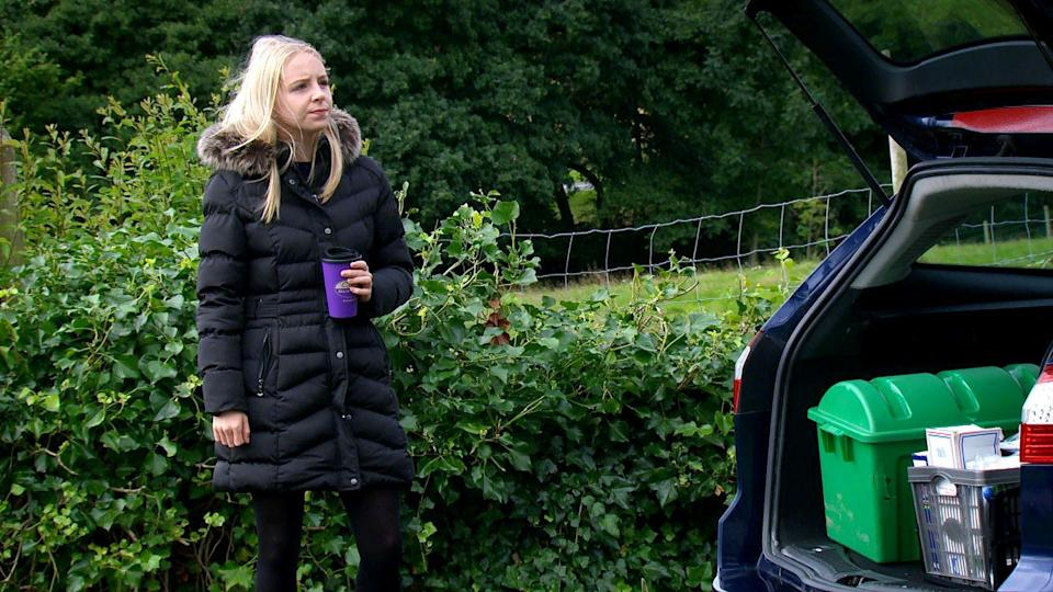 <p>She spies an opportunity when Jamie leaves his car boot open.</p>