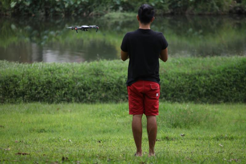 A drone enthusiast flying a drone at Bishan Park. (Yahoo News Singapore file photo)