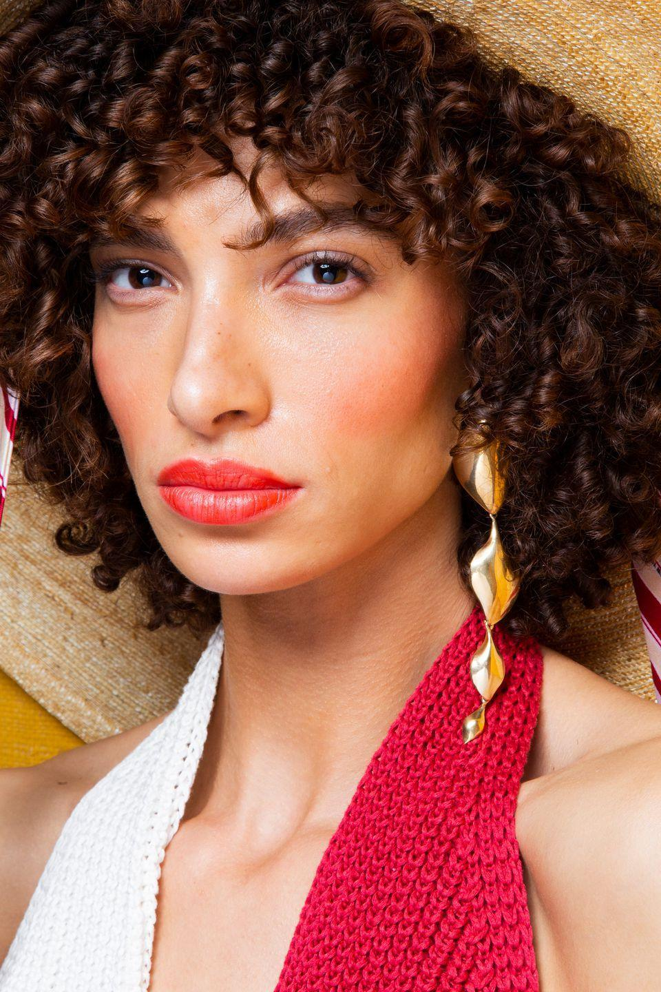 <p>Red lips and a pop of red blush-with minimal eye makeup-backstage at Hellessy.</p>