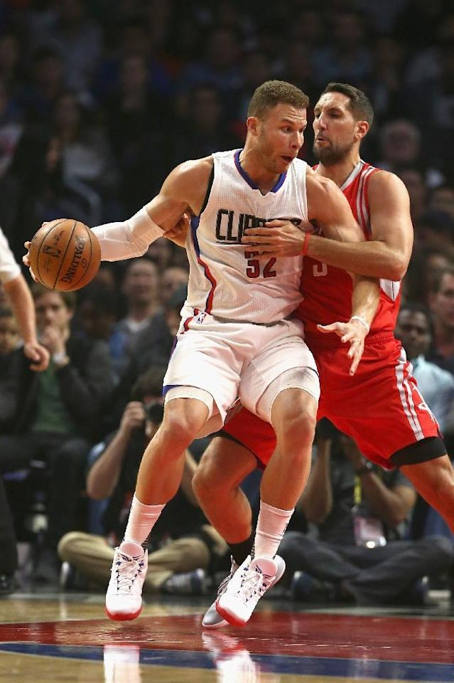 Blake Griffin (L) of the LA Clippers defends against Ryan Anderson of the Houston Rockets during the first half, at Staples Center in Los Angeles, California, on April 10, 2017 (AFP Photo/Sean M. Haffey)