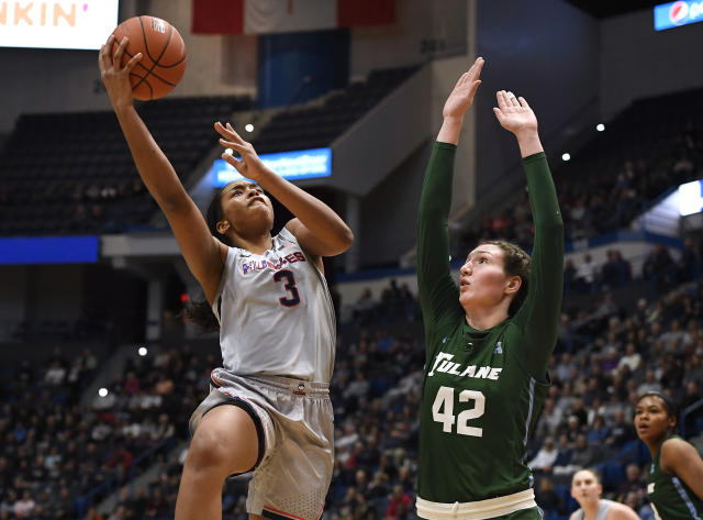 Connecticut's Megan Walker (3) shoots over Tulane's Mia Heide (42) in the first half of an NCAA college basketball game, Wednesday, Feb. 19, 2020, in Hartford, Conn. (AP Photo/Jessica Hill)