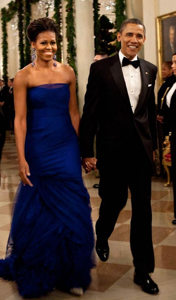 All eyes were on President Barack Obama and his lovely wife, Michelle, as they made their grand entrance at the Kennedy Center Honors reception held at the White House. The First Lady was clearly the belle of the ball in her strapless cobalt blue Vera Wang gown. Such a classy couple! (12/04/2011)