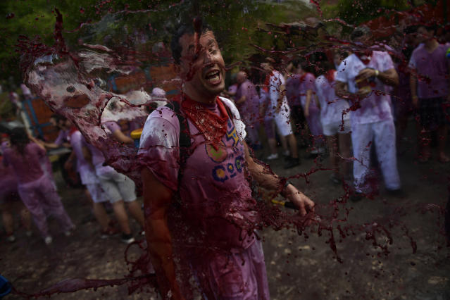 <p>A man has wine thrown on him as he takes part in a wine battle, in the small village of Haro, northern Spain, Friday, June 29, 2018. (Photo: Alvaro Barrientos/AP) </p>