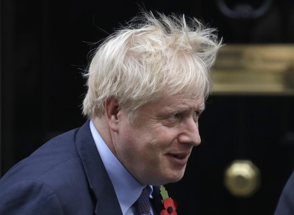 Britain's Prime Minister Boris Johnson leaves 10 Downing Street to attend Parliament in London, Wednesday, Oct. 30, 2019. Britons will be heading out to vote in the dark days of December after the House of Commons on Tuesday backed an early national vote that could break the country's political impasse over Brexit — or turn out to be merely a temporary distraction. (AP Photo/Kirsty Wigglesworth)