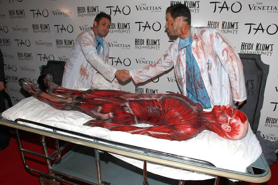 """<p>Talk about commitment. At her first Halloween party of 2011, she dressed as """"the Visible Women"""" and had men dressed as surgeons wheel her out on a gurney. </p>"""