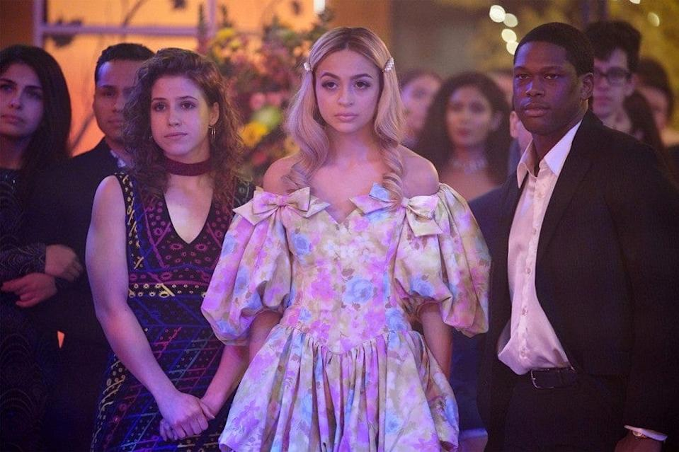 Josie Totah with two other Saved by the Bell characters standing at the front of a crowd